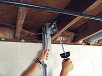 Straightening a foundation wall with the PowerBrace™ i-beam system in a Cordova home.