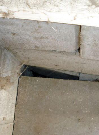 inward rotation of a foundation wall damaged by street creep in a garage in Angoon