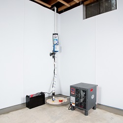 Sump pump system, dehumidifier, and basement wall panels installed during a sump pump installation in Girdwood