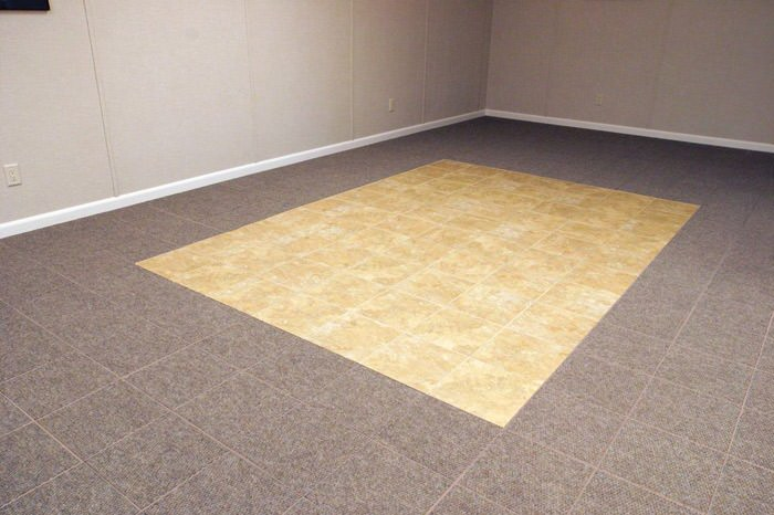 tiled and carpeted basement flooring installed in a Eagle River home